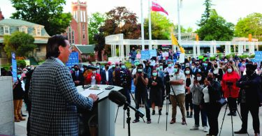 """Brampton Mayor Patrick Brown (left) speaks in front of a group of onlookers Monday evening (June 14), during an interfaith vigil, held in front of Brampton City Hall, to remember members of the Afzaal family, who were targeted by a driver in a """"horrific act of Islamophobia"""" on June 6. (Photo Courtesy of City of Brampton / Urz Heer)"""